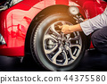 Asian man car inspection Measure quantity Inflated 44375580