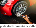 Asian man car inspection Measure quantity 44375582