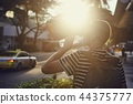 Man drinking water at sunset 44375777
