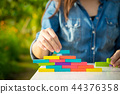 woman playing blocks stack game learning education 44376358