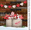 Group of Christmas ornaments in old wooden box 44378693