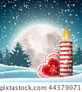Christmas candle in snowy landscape with moon 44379071