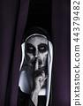 frightening evil nun asking for silence 44379482