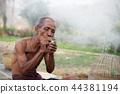 Old man with smoking. 44381194