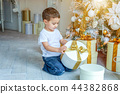 Little boy with gift box near Christmas tree at home 44382868