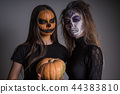 Portrait of girls with makeup of Halloween creatures on a dark background 44383810