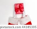 Santa holding a Christmas gift 44385305