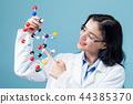 Female scientist with molecule model 44385370