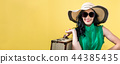 Young woman with a suitcase travel theme 44385435