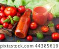 Bottle of fresh organic tomato juice with tomato  44385619
