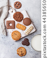 Oat and chocolate cookies selection with glass  44385650