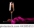 Elegant glass of pink rose champagne raspberry  44385653