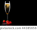 Elegant glass of yellow champagne with strawberry 44385656