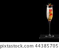 Elegant glass of yellow champagne with raspberries 44385705
