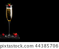 Elegant glass of yellow champagne with raspberry  44385706