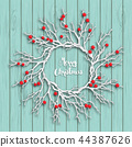 Christmas wreath on blue wooden background 44387626
