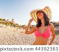 Beautiful happy woman in bikini at the seaside 44392363