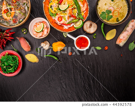 Various of asian meals on rustic background , top view , place for text. 44392578