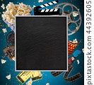 Cinema concept of vintage film reels, clapperboard and other tools. 44392605