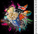 Pop-corn, movie tickets, clapperboard and other things in motion. 44392630