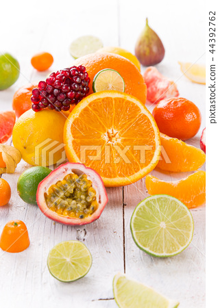 Citrus fruits on white wooden table. 44392762