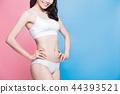 woman show her thin waist 44393521