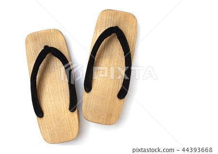 Old wooden Japanese sandal on white background. 44393668