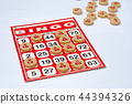 Red bingo card with white chip. 44394326