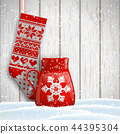 knitted christmas stocking and red tea cup 44395304