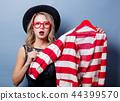 style girl with jacket on hanger  44399570