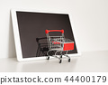 Empty shopping cart and digital tablet 44400179