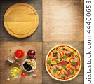 pizza and food ingredients at wooden table 44400653