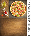 pizza and food ingredients at wooden table 44400655