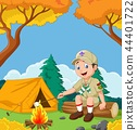 Cartoon scout roasting marshmallow 44401722