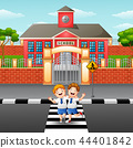 Two students crossing the road 44401842