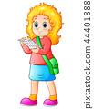 Schoolgirl cartoon reading a textbook 44401888