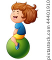 Little girl sitting on green ball 44401910