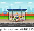 Teacher and children in a bus stop 44401935