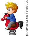 Little boy on rocking horse 44401955
