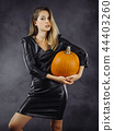 Sexy young woman holding pumpkin for Halloween 44403260
