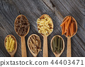 A set of raw pasta on a wooden table 44403471