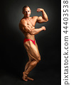 Studio shot of male bodybuilder posing,  44403538