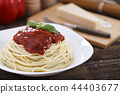 Warm, delicious spaghetti with sauce and basil. 44403677