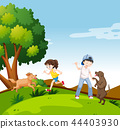 People with dogs in park 44403930