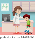 Doctor helping boy with bruise 44404061