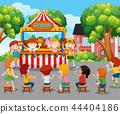 Children watching puppet show outside 44404186