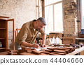 A close up view of a joiner sketching at his workspace 44404660