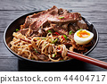close-up of a bowl of Soba noodles and beef 44404717