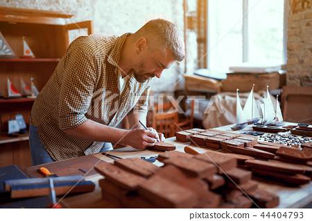 Wood carpenter at work in his workshop 44404793