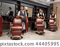Confident masters barbers standing near hairdresser chairs and posing. 44405995
